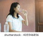 waman drinking water.   Shutterstock . vector #435546856