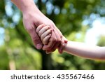 a father holds the hand of a... | Shutterstock . vector #435567466