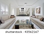 Luxurious living room with grand entrance in the background - stock photo