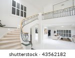 entrance hall in luxury modern mansion - stock photo