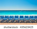 Blue Chairs On The Promenade...