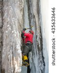 Small photo of Alpinist is climbing on glacial waterfall with drops of ice