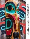 Small photo of Moon Raven totem pole at Saxman Village tribal house near Ketchikan Alaska