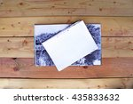 blank paper on wooden background | Shutterstock . vector #435833632
