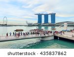 Small photo of Singapore, Republic of Singapore - May 7, 2016: Crowds of tourists admire the view of Marina Bay Sands hotel, ArtScience museum and Flyer near Merlion sculpture