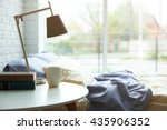 lamp  books and cup on a side... | Shutterstock . vector #435906352