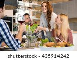 Host Woman Serving Salad To...