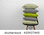 colorful pillows on chair  on... | Shutterstock . vector #435927445