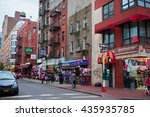 Small photo of NEW YORK CITY - OCTOBER 15, 2014: Street level view of apartments and shops, corner of Mulberry St and Hester St in Chinatown