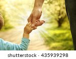 the parent holding the child's... | Shutterstock . vector #435939298