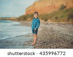 boy with bare feet on the beach | Shutterstock . vector #435996772