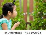 a little girl blowing soap... | Shutterstock . vector #436192975
