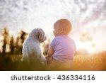 Little Boy And White Puppy...