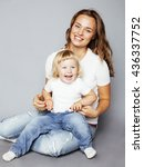 young pretty stylish mother... | Shutterstock . vector #436337752