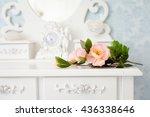 Stock photo tender tea rose on beautiful white dressing table 436338646