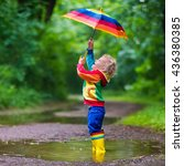 little boy playing in rainy... | Shutterstock . vector #436380385
