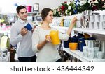 man and woman buying ceramic... | Shutterstock . vector #436444342