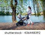 Young Woman With Stroller On...