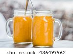 Two Mason Jars With Orange...