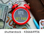 Small photo of Time to get paid. sign on red clock with cash