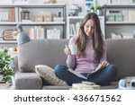 beautiful girl at home sitting...   Shutterstock . vector #436671562