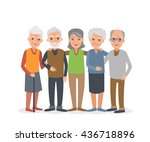 group of elderly people stand...