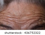 wrinkles on the forehead of a... | Shutterstock . vector #436752322