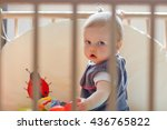 baby girl inside a playpen | Shutterstock . vector #436765822