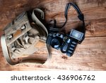 old camera and bag  wooden... | Shutterstock . vector #436906762