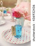 Small photo of Blue drink in bottle, Alice in wonderland tea party theme,toning