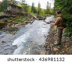 A Fisherman Caught Trout On Th...