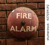 Small photo of Rustic Vintage Fire Alarm Bell Against A Red Brick Wall