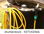 yellow water hose with nuzzle... | Shutterstock . vector #437142466