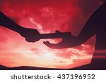Small photo of Man passing the baton to partner on track against sky and mountains Man passing the baton to partner on track at the gym