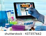 scientist holding tube and... | Shutterstock . vector #437357662