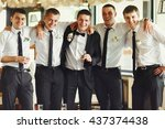 groom and his friends pose in a ... | Shutterstock . vector #437374438