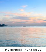 Small photo of Beach sunset skyline afterglow
