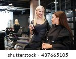 young hairdresser with hair... | Shutterstock . vector #437665105