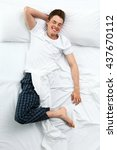 handsome man in bed  top view | Shutterstock . vector #437670112