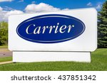 Small photo of BLOOMINGTON, MN/USA - MAY 29, 2016: Carrier Corporation sign and symbol. Carrier manufacturers heating, ventilating and air conditioning systems.