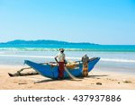 Two Fishermen Reviewing The...