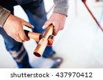 industrial plumber cutting a... | Shutterstock . vector #437970412