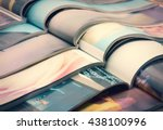 pile of magazines   colorful | Shutterstock . vector #438100996