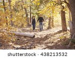 smiling couple hike in forest... | Shutterstock . vector #438213532