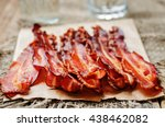Baked Slices Of Bacon On A Dar...