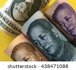 US dollar and Chinese renminbi banknotes, represening dollar/yuan exchange rate