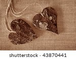 Two Wooden Hearts On Brown...