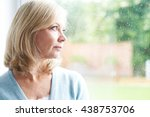 sad mature woman suffering from ... | Shutterstock . vector #438753706