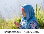 muslim woman reading holy quran | Shutterstock . vector #438778282