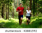 A Couple Jogging In Forest
